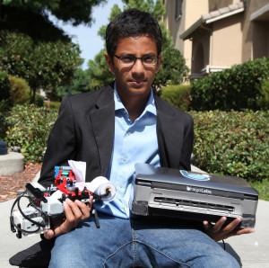 Shubham Banerjee holding Braigo v1.0 and v2