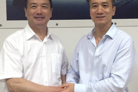 Lixiang Chen (left), Chairman of the board of Zhejiang VIE Science & Technology CO., Ltd., and Chairman of the board of VIE Group CO., Ltd., shaking hands with KwokYin Chan (right), CEO of Protean Electric